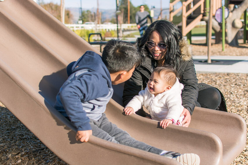 Barb, Gabriel and Emilia playing on the slide