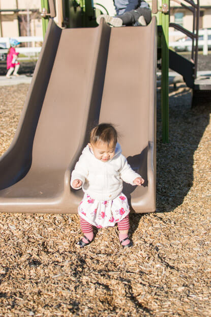 Emilia standing at the bottom of the slide