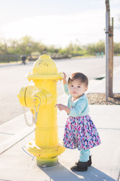 Emilia standing by fire hydrant