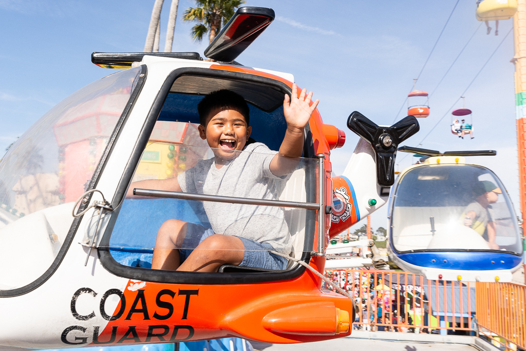Gabe waving from the helicopter ride at Santa Cruz Beach Boardwalk