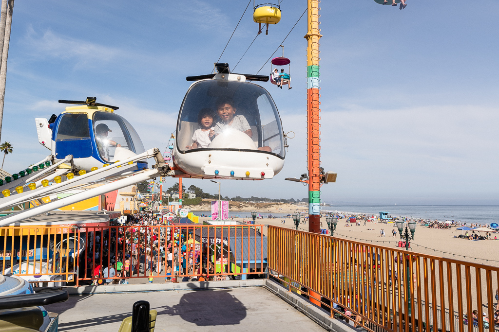 Gabe and Emilia on the helicopter toddler ride at Santa Cruz Beach Boardwalk