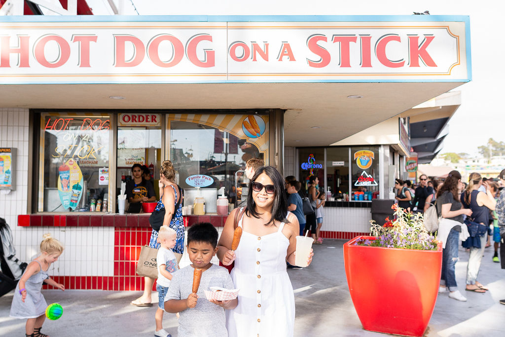 Barb with her food at Hot Dog on a Stick at Santa Cruz Beach Boardwalk