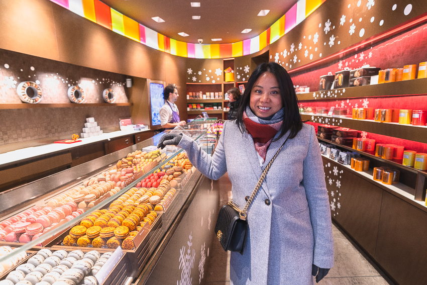 Barb buying macaroons at Pierre Herme Paris France